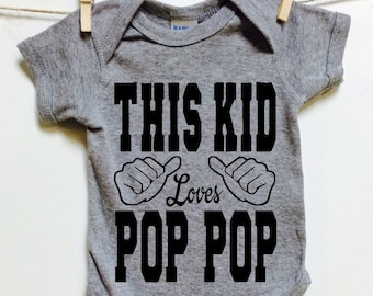 This Kid loves Pop Pop. Gray cotton one piece romper. Great Baby shower Gift. Baby announcement gift idea. Pop. Grandparent gift