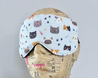Sleep mask in pale blue cat print. Cat print eye mask.