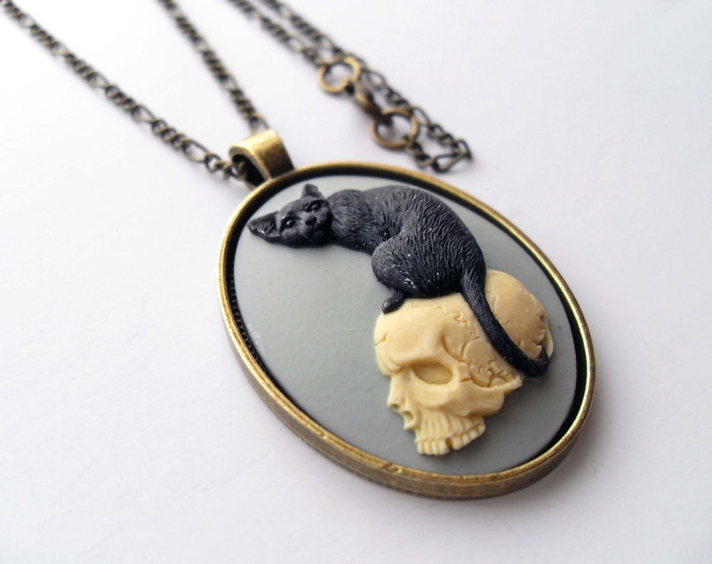 Halloween Witchcraft jewelry. Gothic dark mori pendant Witchy black cat on macabre skull cameo necklace