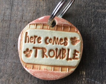 """Dog Tag/Keychain - """"Here Comes Trouble"""" - Pink"""