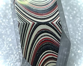 Pieces are Laminated Together Black Glass Base Hand-Faceted Button ~ Fordite Small