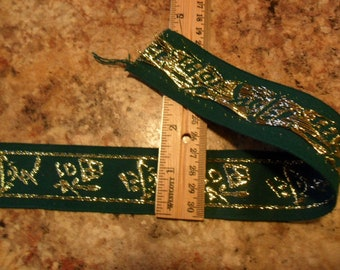 "Dark Green Trim w/Gold Metallic oriental Script 1 yard x 1 1/4"" width -have 20 yards available for purchase"