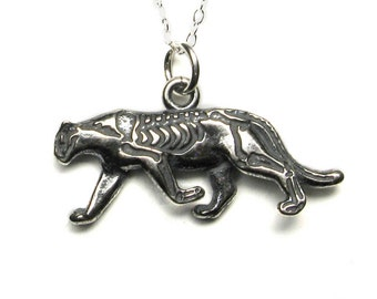 Solid sterling silver walking cougar (puma or mountain lion) pendant or charm with skeleton etched on one side, antique patina. Big cat.