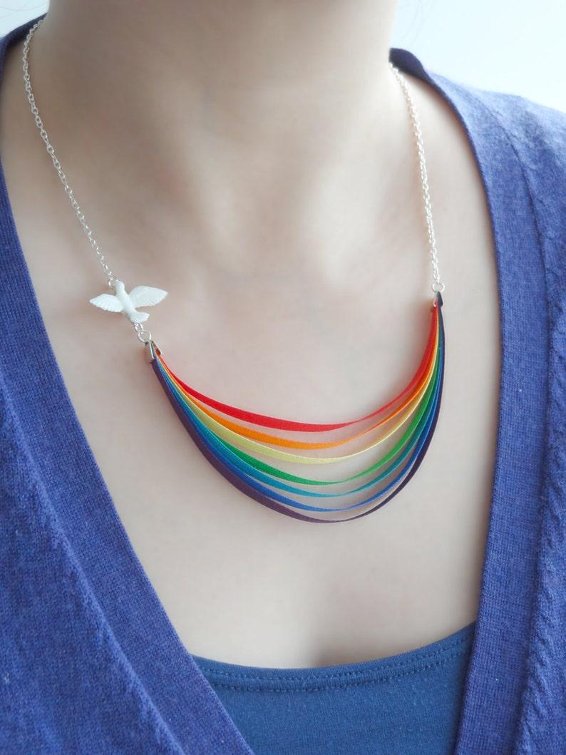 Here Comes the Sun  rainbow dove and last drop of rain  image 0