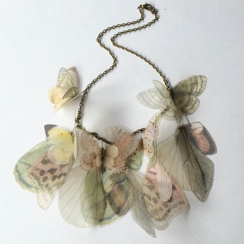 Butterfly and Wings Necklace in Pastel Pink Green Yellow image 0
