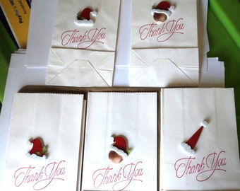 """9 White Paper Sacks  6.5"""" x 3.5"""" x 2"""" Holiday Gift Bags Merchandise Thank You Stamped in Red with Santa Hat Embellishments Takuniquedesigns"""