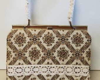 Upcycled vintage brocade snap closure frame bag with lace accents.