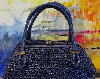 Cadet blue Dayne Taylor raffia crocheted frame handbag with beaded accents.