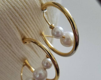 Chic swirling golden pearl accented hoops