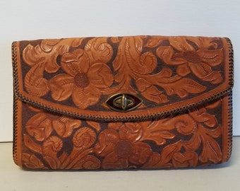 Beautifully hand tooled, hand braided leather clutch bag