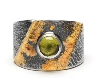Peridot wrap ring with fused sterling silver and 14K gold