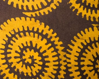 Tanzanian cotton batik - 1/2 yard of yellow and brown coils