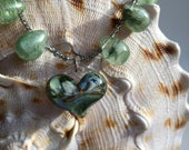 Stunning handmade special glass heart necklace with greens and golds