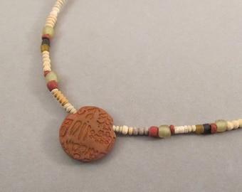 Copper Lentil Bead Necklace with Proto-Elamite Script