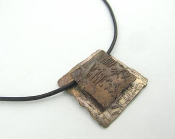 Bronze and Copper Ancient Scripts Necklace