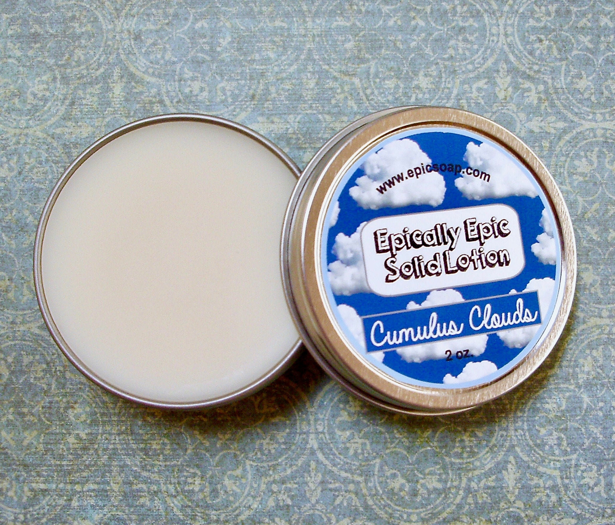 Cumulus,Clouds,Many,Purpose,Solid,Lotion,-,Limited,Edition,Into,the,Summer,Scent,Bath_And_Beauty,hand_cream,body_butter,lotion_bar,epically_epic,solid_lotion,vegan_lotion,cuticle_butter,scented_lotion,into_the_summer,cumulus_clouds,blue_sky,clean_air_scent,white_vanilla,macadamia butter,jojoba,candelilla wax,coconut oil,olive squalane