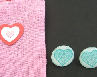 "Blue Heart Earrings. Post or Stud Earrings.  5/8"" or 16 mm Round.  In Hand Dyed Pink Fabric Decorated Bag."
