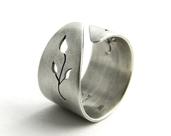 Hand-cut sterling silver ring with botanical design. Oxidized finish.