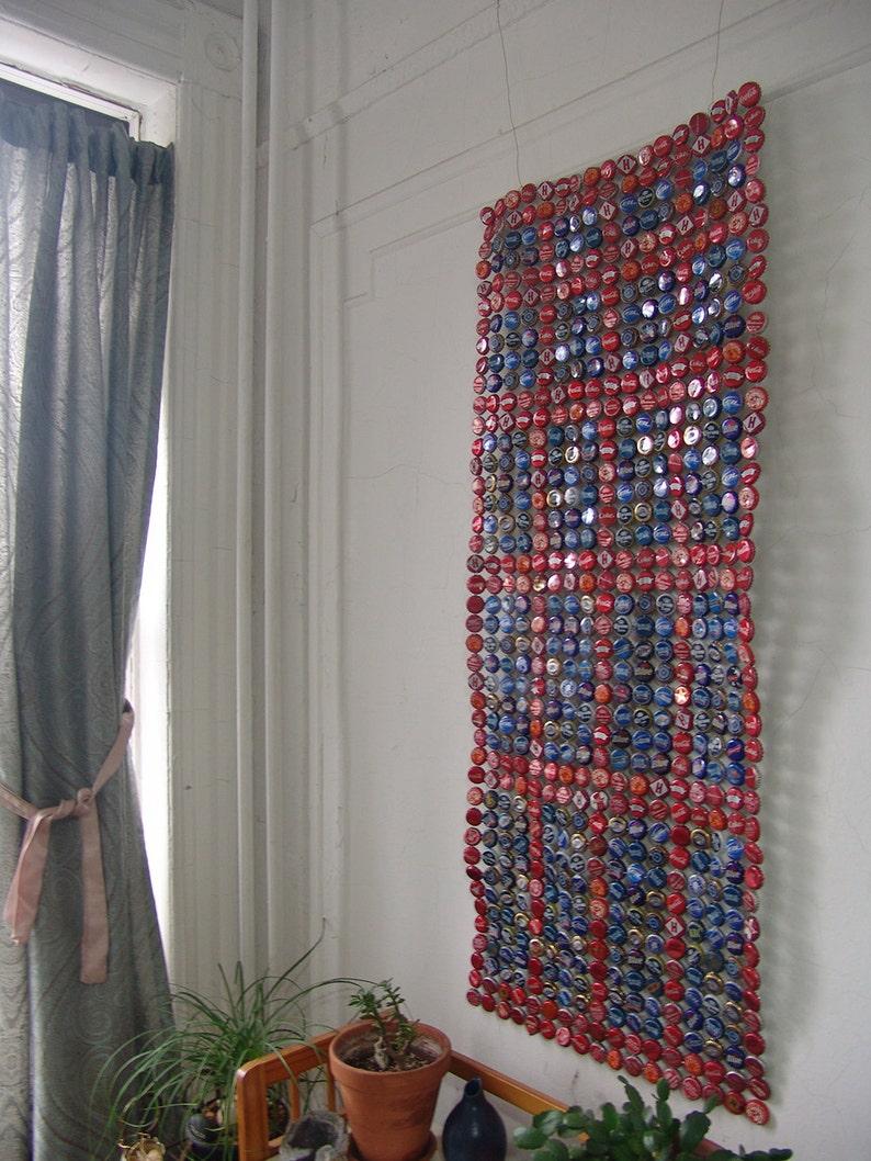 red framing blue  bottle cap tapestry image 0