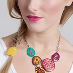 Bright colored bib necklace with embroidery