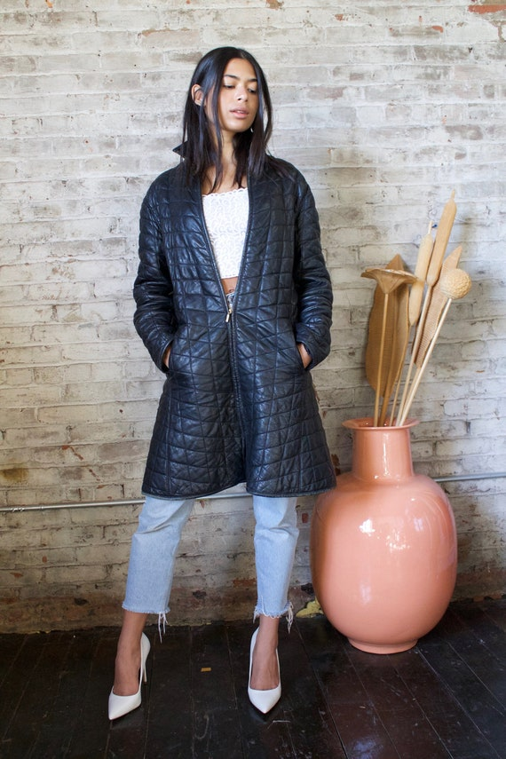 vintage quilted black leather puffer coat / 1980s