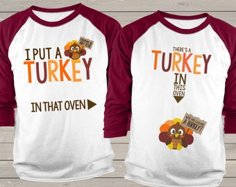 Daddy / mommy Thanksgiving set -  there's a turkey in this oven pregnancy announcement unisex adult raglan TWO maroon shirt set SNLF-017-018