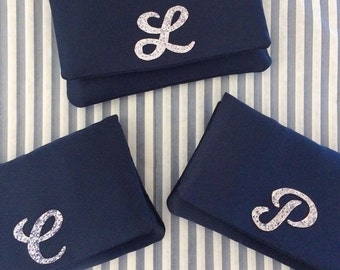 Bridesmaid clutch purse gifts can be made in custom colours
