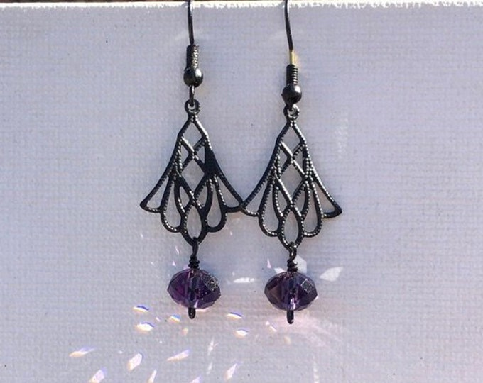 Periplo. Drop earrings with czech glass faceted beads and a delicate black metal component. Festive. Elegant.