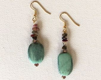 GreenwoodE with tourmaline and green died wood beads, finished with two faceted quartz round beads.