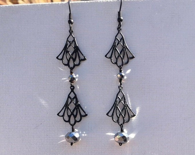 Silvie. Drop earrings with czech glass faceted beads and delicate black metal components. Chandelier style. Festive. Elegant. Bold.