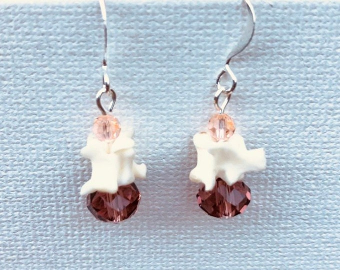 Snake Vertebrae. Unique and interesting earrings made out of the vertebrae of a snake czech and swarovski beads.