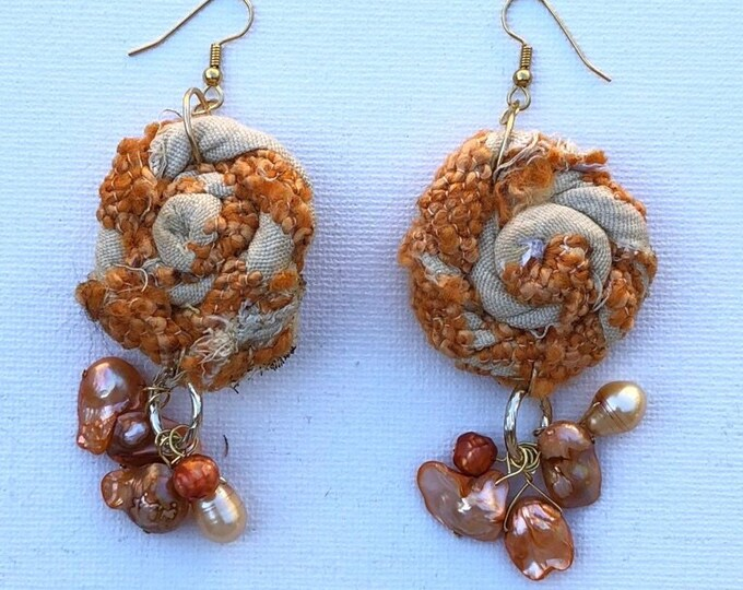Orange fabric dangle and drop earrings with orange pearls