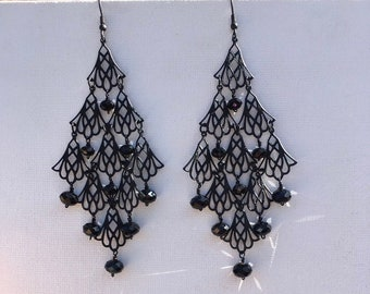 Black metal chandalier earrings with sparkling black crystal faceted rondels. Elegant. Bold.