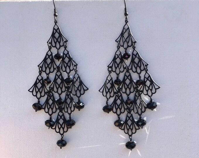 Black metal chandalier earrings with sparkling black crystal faceted rondels. Elegant. Bold.