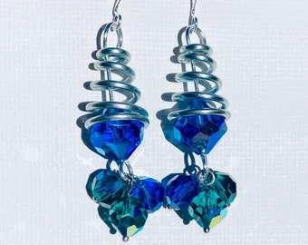 Peackok Spring, Bling and shiny earrings made out of czech glass set on a silver metal spring