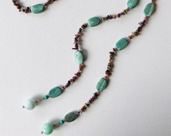 Greenwood Unique and versatile open wrap necklace with tourmaline and green died wood beads, finished with two faceted quartz round beads.
