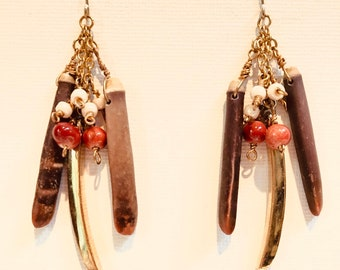 Buntu - Bold ethnic earrings. Urchin and beads dangling off chain.