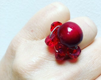 Berry Ring. Deep and rich red wood bead and glass beads on silver wire.