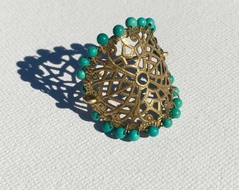 Celosia Ring. Vintage brass plate framed with tiny turquoise beads on a thin shank. Extremely comfortable.