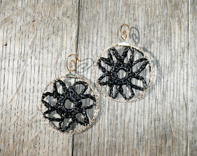 Unique flower crochet hoop earrings made out of upcycled plastic thread and gold tone wire.