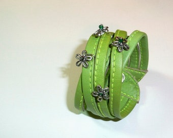 Prado. Fun green leather stripes cuff bracelet.