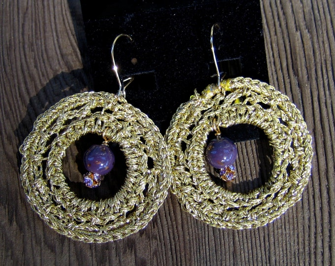 EDonut - Metallic gold thread crochet hoops featuring a purple and gold bead and a Swarovsky bead