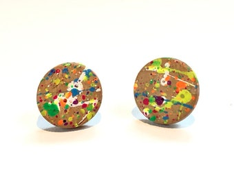 Cork pierced earrings splattered with paint. Simple. Everyday. Perfect for a girl. Fun.