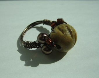 Revici ring, bold ring mixing bone and pearls.