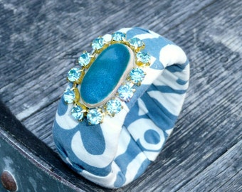 Blue Pine Apple bangle bracelet made out of recycled fabric in blue and white.