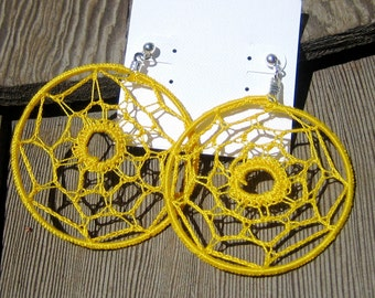 Webloops - Unique yellow crocheted earrings.