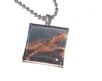 Crush - Sea Turtle closeup shot in a silver square resin pendant on a ballchain.