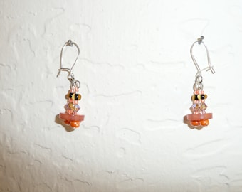 Robot. Orange earrings with buttons, swarovsky crystals and beads.