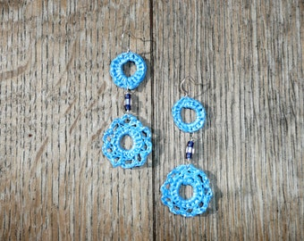 Double Duty Blue - Unique dangling flower shaped earrings made by recycling a plastic shopping bag.
