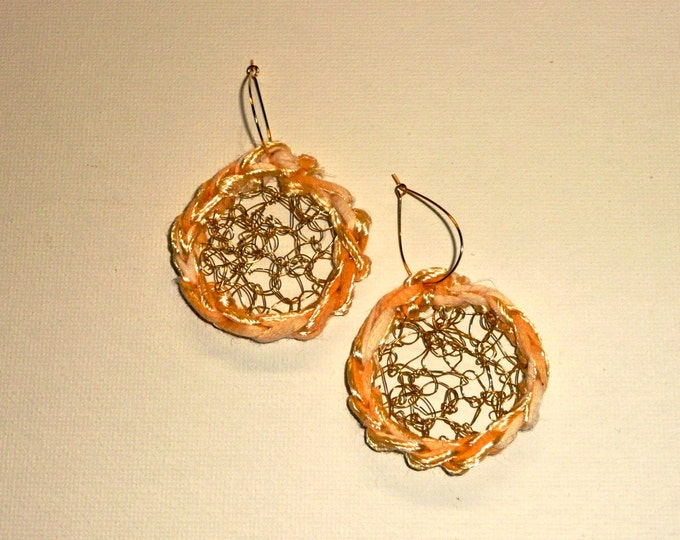 Yellow Mesh earrings. Two discs crocheted in gold tone wire trimmed with a beautiful yellow yarn.